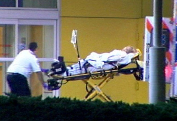 In this image from NBC affiliate WESH, EMS arrive at Health Central Hospital with a woman who was transported from Tiger Woods' home in Florida, early Tuesday, Dec. 8, 2009.