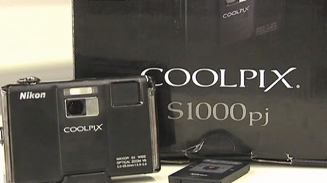 Consumer Reports tests the Nikon Coolpix, the first digital camera with a built-in projector. Dec. 8, 2009.