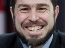 Maher Arar smiles as he discusses the governments apology and compensation package at a news conference in Ottawa Friday Jan 26, 2007. (CP / Tom Hanson)