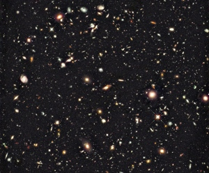 Captured by the Hubble Space Telescope, the faintest and reddest objects are galaxies that formed 600 million years after the Big Bang. (NASA)