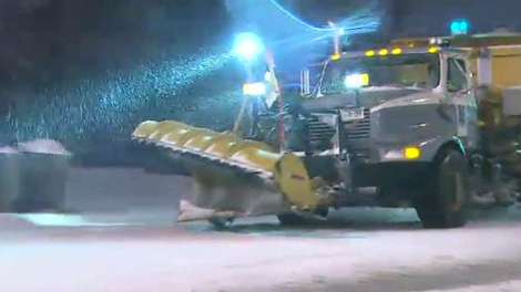 A snowplow hits the streets as the first big snow storm of the season hits Toronto, early Wednesday, Dec. 9, 2009.