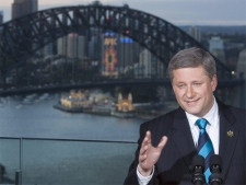 Canadian Prime Minister Stephen Harper answers reporters questions at a news conference overlooking Sydney Harbour following the APEC summit in Sydney, Australia Sunday Sept 9, 2007. (CP / Tom Hanson)