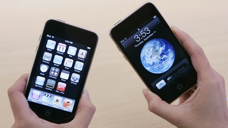 A shopper looks at two new second generation Apple iPod Touches at an Apple store in Palo Alto, Calif. on Sept. 11, 2008. (AP / Paul Sakuma)
