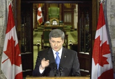 Prime Minister Stephen Harper apologizes on behalf of the government of Canada to Maher Arar on Parliament Hill in Ottawa on Friday. (CP / Tom Hanson)