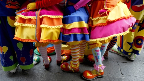 Clowns wait together in Mexico City, Wednesday, July 22, 2009. If the circus is your party theme weave Dollar Store streamers, long, paper snakes and stuffed toy lions around doorways. (AP / Eduardo Verdugo)