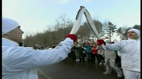 Maxime Remillard (right) lights Todd van der Heyden's torch in Ste. Marthe sur le Lac (Dec. 10, 2009)
