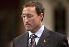 Minister of National Defence Peter MacKay rises to answer a question during question period on Parliament Hill in Ottawa, Wednesday, Dec. 9, 2009. (Adrian Wyld / THE CANADIAN PRESS)