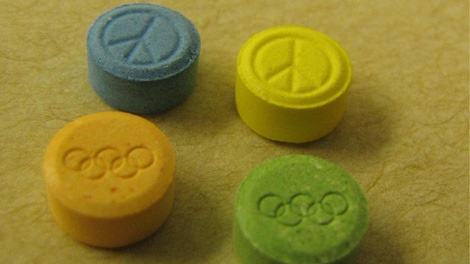 Police seized more than 100,000 ecstasy pills, some of which were stamped with Olympic rings. Dec. 10, 2009.