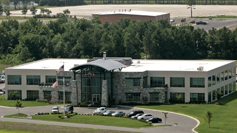 In this July 28, 2008 photo, Blackwater Worldwide's headquarters is seen in Moyock, N.C. Private security guards working for Blackwater USA participated in clandestine CIA raids against suspected insurgents in Iraq and Afghanistan, The New York Times reported Thursday, Dec. 10, 2009 (AP Photo/Gerry Broome)