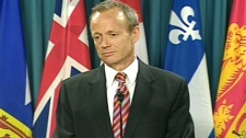 International Trade Minister Stockwell Day speaks with reporters in Ottawa, Friday, Dec. 11, 2009