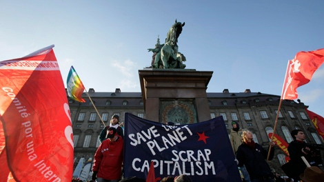 Protestors gather outside parliament in the centre of Copenhagen, Saturday, Dec. 12, 2009. (AP / Peter Dejong)