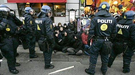 Police surround some of thousands of people demonstrating on the street in central Copenhagen, Denmark, Saturday, Dec. 12, 2009. (AP / Polfoto, Jens Dresling)