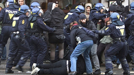 Police make arrests of some of thousands of people demonstrating on the the street in central Copenhagen, Denmark, Saturday, Dec. 12, 2009. (AP / Polfoto, Jens Dresling)