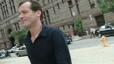 Igor Kenk runs past CTV cameras as he leaves Old City Hall courts on Friday, Aug. 1 2008.