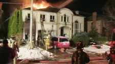 Firefighters spent the night at the scene of a three-alarm fire that destroyed a mansion in the York Mills and Bayview area on Dec. 15, 2009.