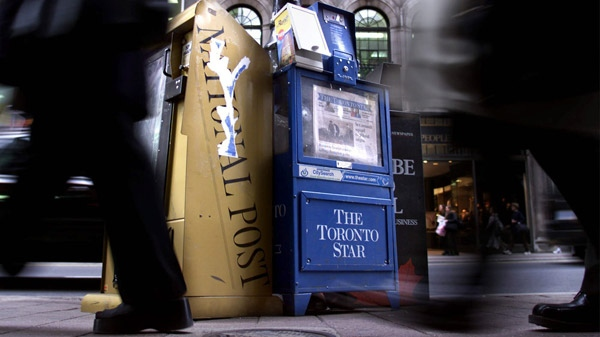 Three of Toronto's english language daily newspapers sit in boxes on a street corner in downtown Toronto, Tuesday, Oct. 26, 1999. (Kevin Frayer / THE CANADIAN PRESS)
