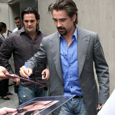 Colin Farrell, who's received much fanfare for his generous donations to a homeless man in Toronto this week, signs for fans in Toronto. (Sean O'Neill for eTalk)