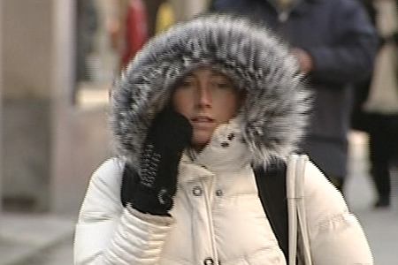A woman stays bundled up against the frigid cold in Montreal on Friday, Dec. 18, 2009.