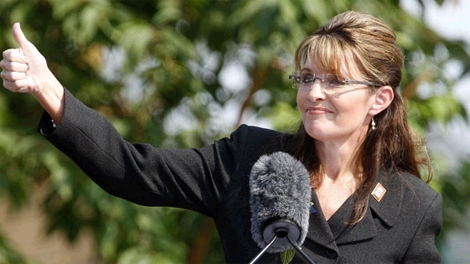 Alaska Gov. Sarah Palin gives a thumbs up during her resignation speech during a ceremony in Fairbanks, Alaska, Sunday, July 26, 2009. (AP / Al Grillo)