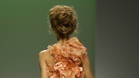 A model wears an updo during Colombian designers Francisco Leal and Karen Daccarett women's Spring/Summer 2010 fashion show, presented in Milan, Italy, Wednesday, Sept. 30, 2009. (AP / Alberto Pellaschiar)