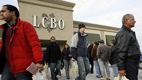 Patrons line up to get into an LCBO outlet as others leave after stocking up with their New Years Eve beverages in Mississauga, Ont. on Dec. 31, 2007. (THE CANADIAN PRESS/J.P. Moczulski)