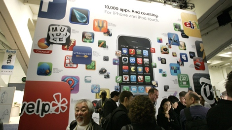 A poster touting applications available for Apple's iPhone and iPod touch is seen at the Macworld Conference and Expo in San Francisco on Jan. 6, 2009. (AP / Paul Sakuma)