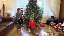 The Lavin children play near the Christmas tree. Dec. 22, 2009. (CTV)