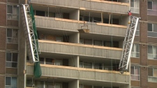 The broken scaffolding lies handing on the side of the building as Ministry of Labour officials investigate the incident, Friday, Dec. 25, 2009. The scaffolding couldn't immediately be removed as it was deemed too dangerous.