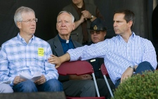 Ontario Liberal leader Dalton McGuinty pats federal Liberal leader Stephane Dion on the arm during the opening ceremonies at the International Plowing Match in Crosby, Ontario, Tuesday Sept. 18, 2007. (CP / Tom Hanson)