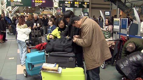 Transportation Canada announced new carry-on restrictions for all U.S.-bound flights Monday. Dec. 28, 2009.