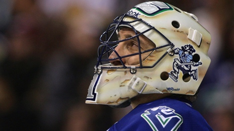 Vancouver Canucks' goalie Roberto Luongo looks on during a break in play against the Edmonton Oilers during first period NHL action in Vancouver, B.C., on Saturday December 26, 2009. THE CANADIAN PRESS/Darryl Dyck