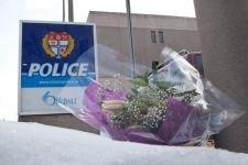 Flowers are seen outside of Ottawa Police Headquarters after an on duty officer was stabbed in his police cruiser outside of the Civic Hospital in Ottawa on Tuesday, Dec. 29, 2009. (Pawel Dwulit / THE CANADIAN PRESS)