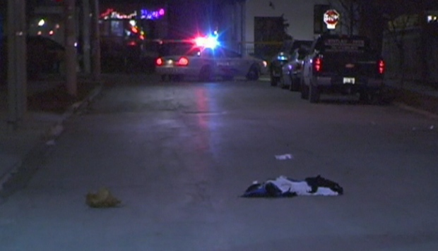 Clothing lies on the street as police investigate Toronto's 62nd homicide of the year near Gilmour Ave. and Dundas St. W. area, late, Tuesday, Dec. 29, 2009.