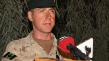 Brig.-Gen. Daniel Menard  announces the death of four soldiers and a journalist at Kandahar Airfield on Thursday, Dec. 31, 2009. (Colin Perkel / THE CANADIAN PRESS)