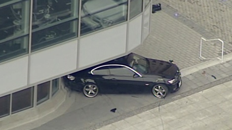 A BMW crashed into the CBC building in downtown Vancouver Tuessday during an apparent carjacking. Police reported four injuries and damage to several vehicles. Dec. 29, 2009. (CTV)