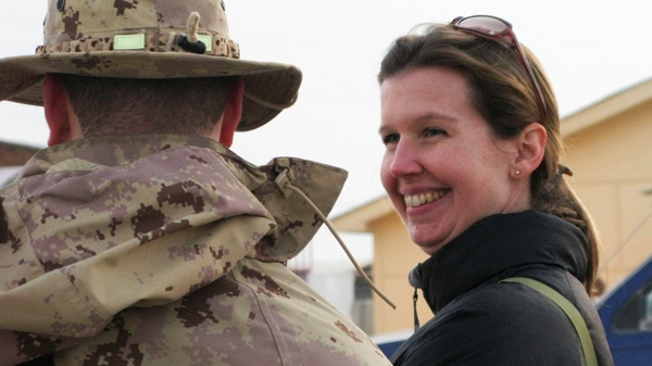 Calgary-based reporter Michelle Lang speaks with a Canadian soldier at Kandahar Airfield on Saturday, Dec. 12, 2009. (Colin Perkel / THE CANADIAN PRESS)