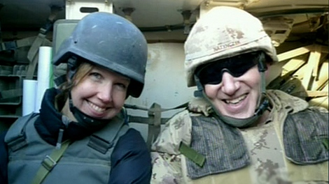 Journalist Michelle Lang sits in the back of an armoured vehicle with Chief of Defense Staff Gen. Walter Natynczyk.