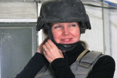 Calgary-based reporter Michelle Lang, 34, tries on her fragmentation vest and helmet at Kandahar Airfield on Sunday, Dec. 13, 2009. Lang was killed along with four Canadian soldiers by an improvised explosive device on Wednesday, Dec. 30, 2009, the first Canadian journalist killed in Afghanistan. (THE CANADIAN PRESS/ Colin Perkel)