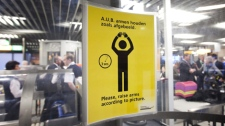 An instruction sign is seen inside a body scanner at Schiphol airport, Netherlands, Monday, Dec. 28, 2009. (AP Photo/Cynthia Boll)