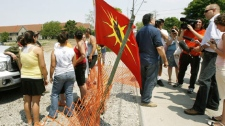 Garry Sault, middle, talks with the media after questioning Six Nations protesters as they guard the front entrance of a housing development in Hagersville, Ont., just south of the 15-month aboriginal occupation at Caledonia on Wednesday, May 23, 2007. (Nathan Denette / THE CANADIAN PRESS)