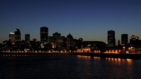 A dimmed Montreal skyline can be seen a couple of minutes after 8pm on earth day, Saturday March 29, 2008.(Graham Hughes / THE CANADIAN PRESS)