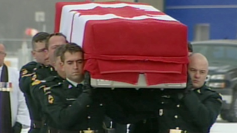 The casket of journalist Michelle Lang is carried to a waiting hearse during a repatriation ceremony at CFB Trenton on Sunday, Jan. 3, 2009.