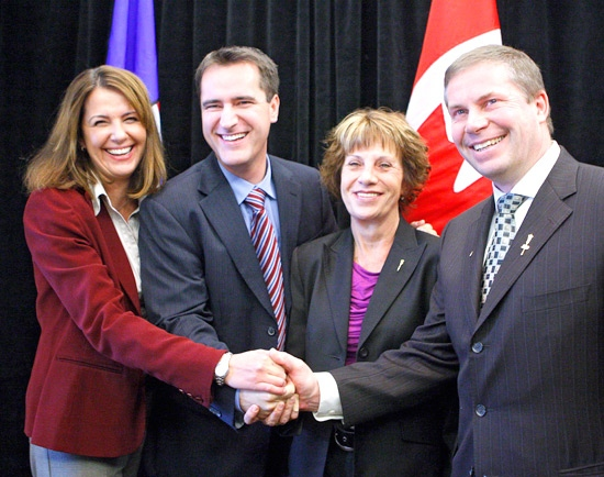 Wildrose Alliance Leader Danielle Smith, left, and deputy leader Paul Hinman, right, are joined at a news conference by former Alberta Conservative party MLAs Rob Anderson, second from left, and Heather Forsyth, after the two announced their defections from the Alberta Tory party to the Wildrose Alliance in Calgary, Monday, Jan. 4, 2010. THE CANADIAN PRESS/Jeff McIntosh