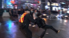 A Vancouver police officer was captured on video throwing a New Year's Eve reveller down to the ground in downtown Vancouver. (CTV)