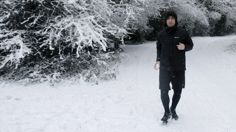 Liam Gallagher, lead singer of Oasis, prepares to throw a snowball whilst jogging on Hampstead Heath in London, Wednesday, Jan. 6, 2010. (AP / Matt Dunham)