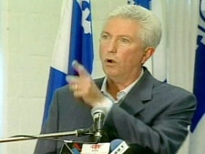 Gilles Duceppe gestures while making his emphatic speech in which he threatened to vote against Harper's throne speech, Sept. 22, 2007.