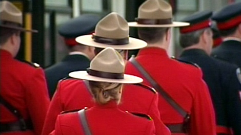 RCMP officers arrive at the memorial service for Const. Eric Czapnik in Ottawa, Thursday, Jan. 7, 2010.