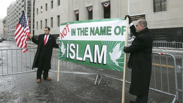 Ibrahim Al Jahim, left, and Maged Moughni, right, stand outside the Theordore Levin United States Courthouse in Detroit, Friday, Jan. 8, 2010. (AP / Jerry S. Mendoza)