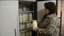 Home on the Range owner Alice Jongerden holds up a jar of raw milk from her Chilliwack, B.C., farm. January 8, 2010.
