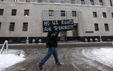 A protester, who refused to give his name, holds a sign outside the Theodore Levin United States Courthouse in Detroit, Friday, Jan. 8, 2010. (AP / Paul Sancya)